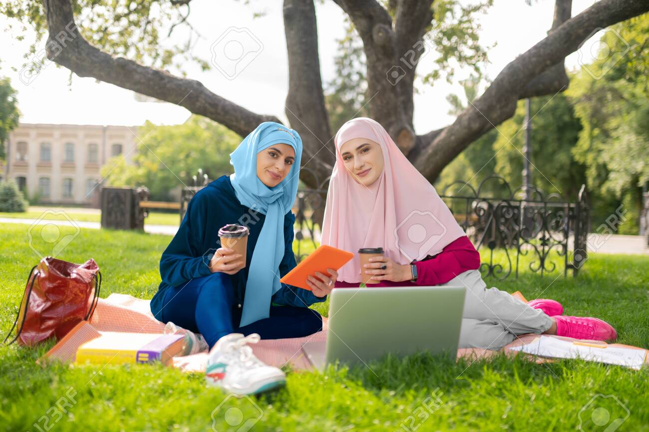 Muslim Students Beautiful Muslim Students Wearing Hijab Enjoying Stock Photo Picture And Royalty Free Image Image 130498122