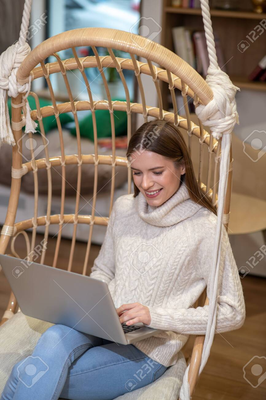 Doing important work. A concentrated woman using her laptop while working - 137174246