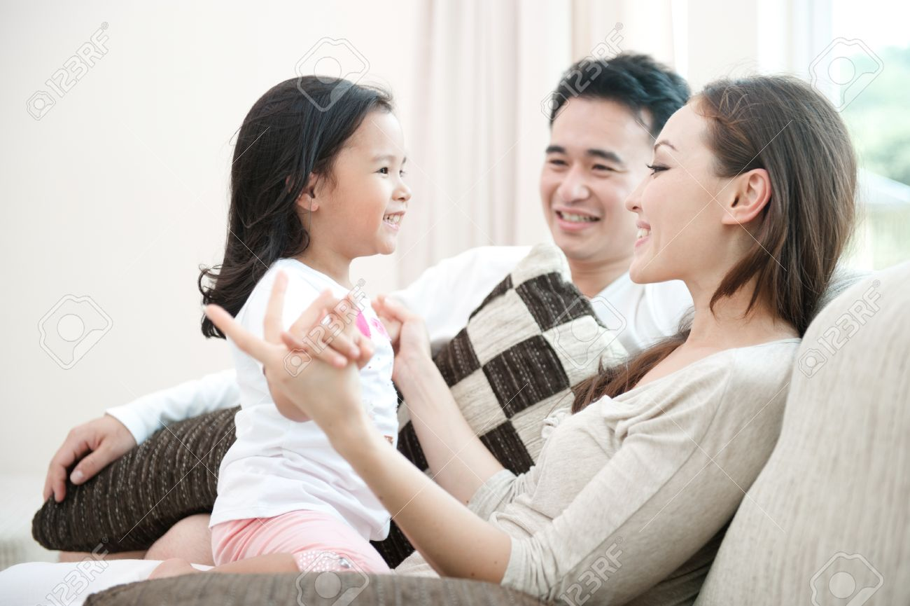 Happy Asian Family Playing With Daughter In The Living Room Stock ...