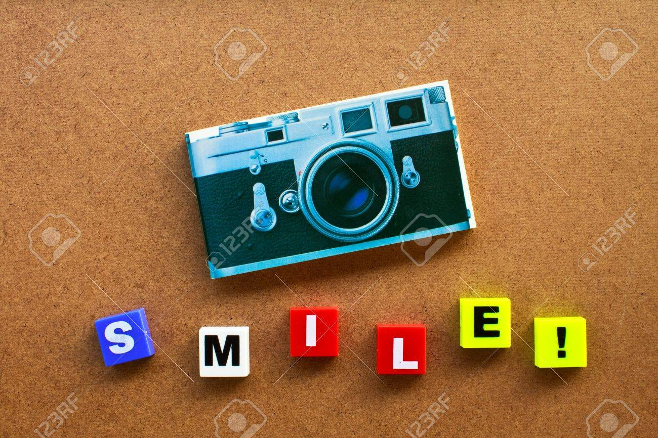 alphabet and camera made by plastic on wood board,for you Stock Photo - 7695928