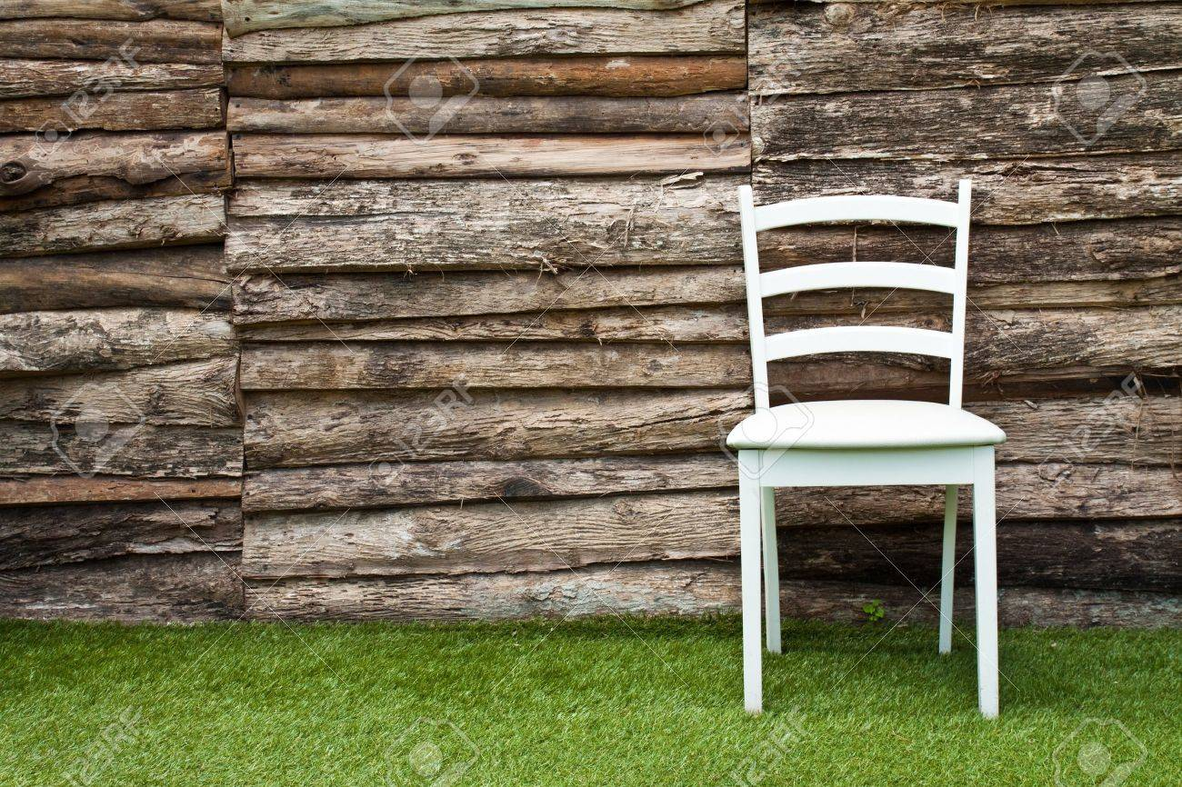 A white wood chair in living room on green grass Stock Photo - 10014737