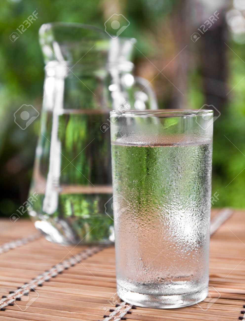 drinking water in glass on the table Stock Photo - 10397127