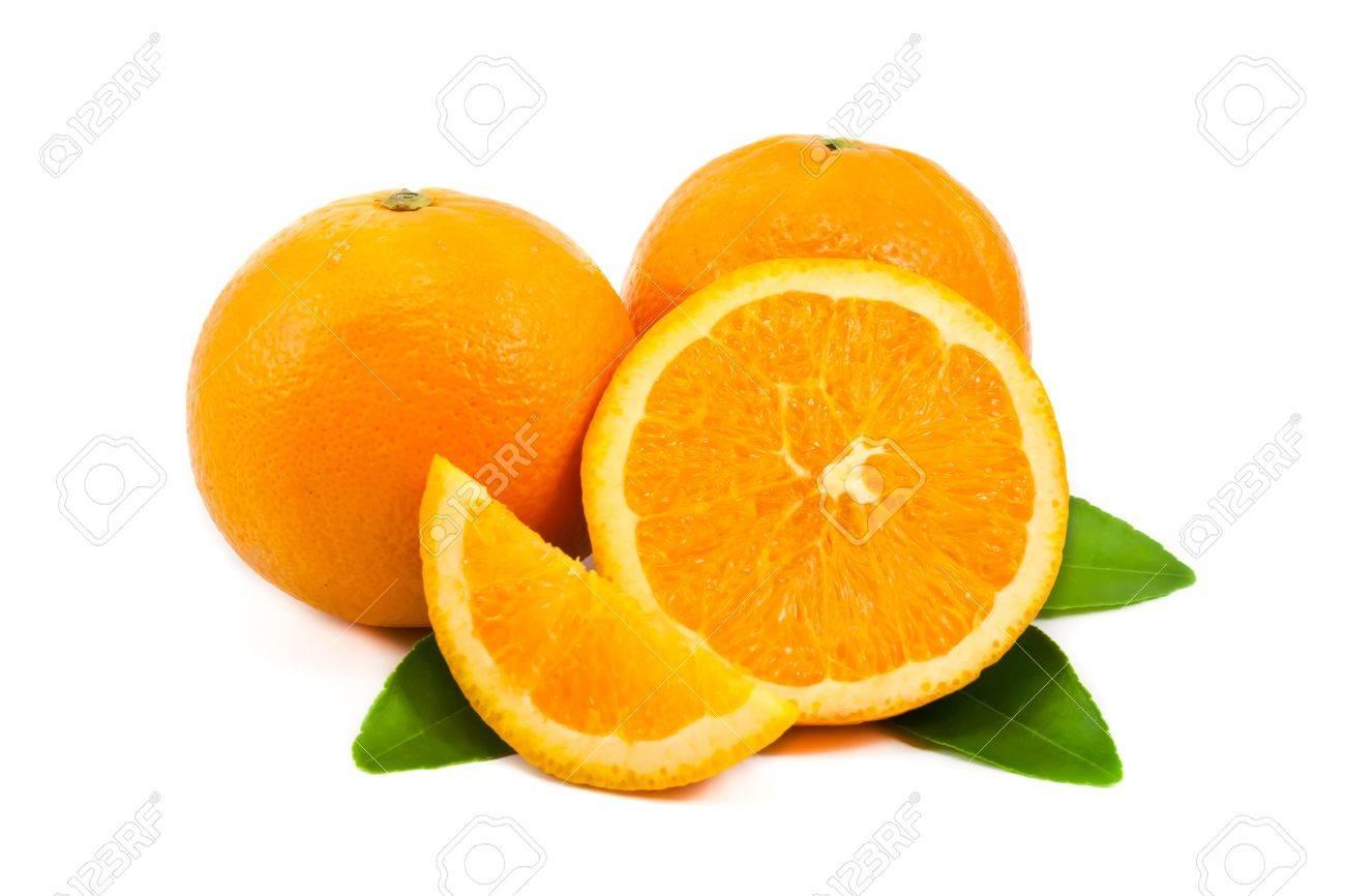 Slice of orange with green leaf isolated on white background Stock Photo - 10662476