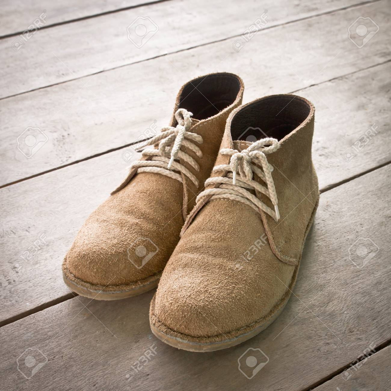 brown boots on wood Stock Photo - 15532704