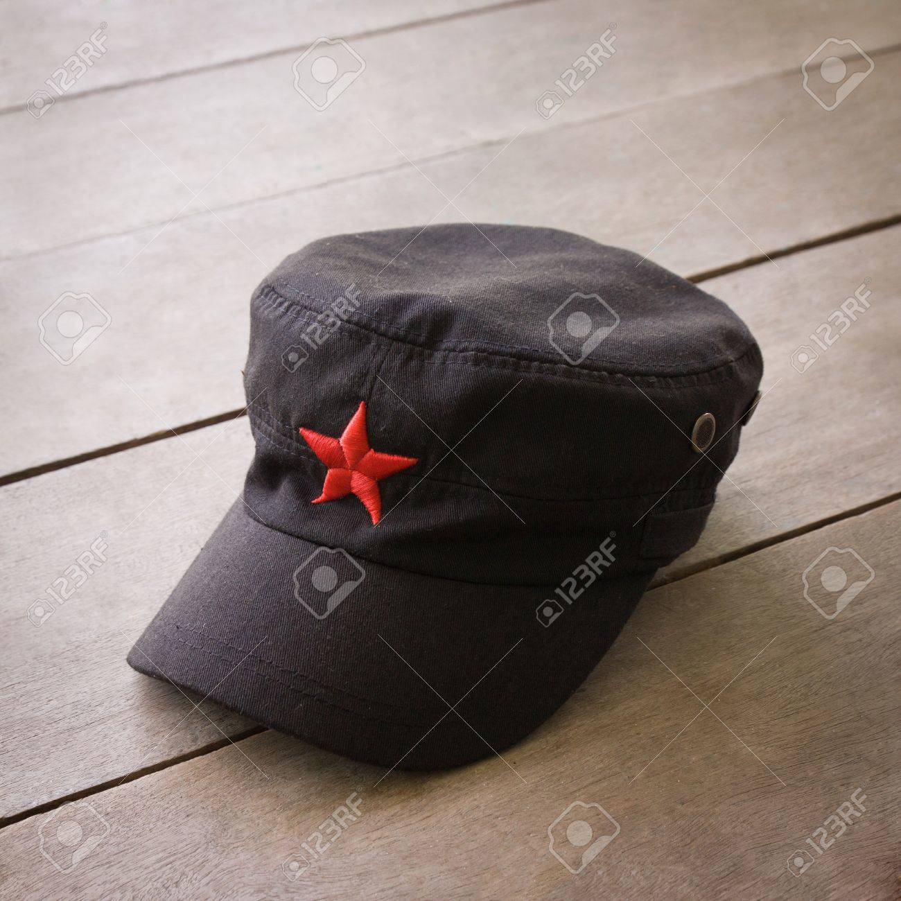 093039276 communist hat and red star on wooden floor