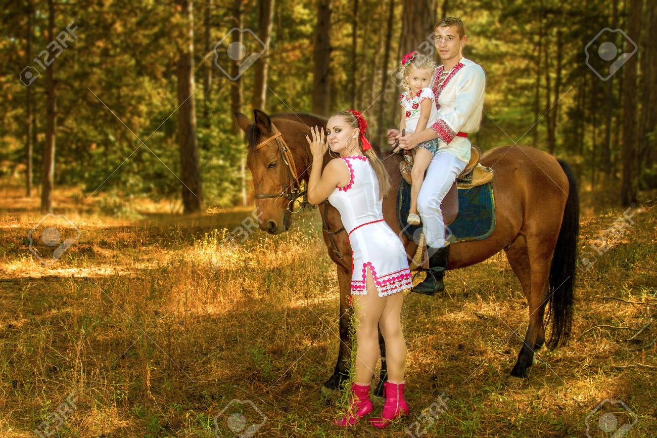 Ukrainians Mom And Dad And Daughter In The Woods With A Horse Stock Photo Picture And Royalty Free Image Image 72087432