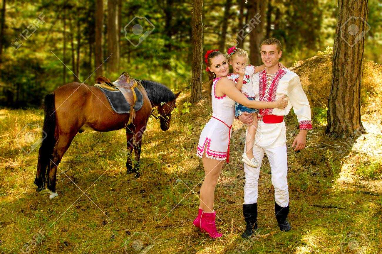 A Ukrainians Mom And Dad And Daughter In The Woods With A Horse Stock Photo Picture And Royalty Free Image Image 81649046