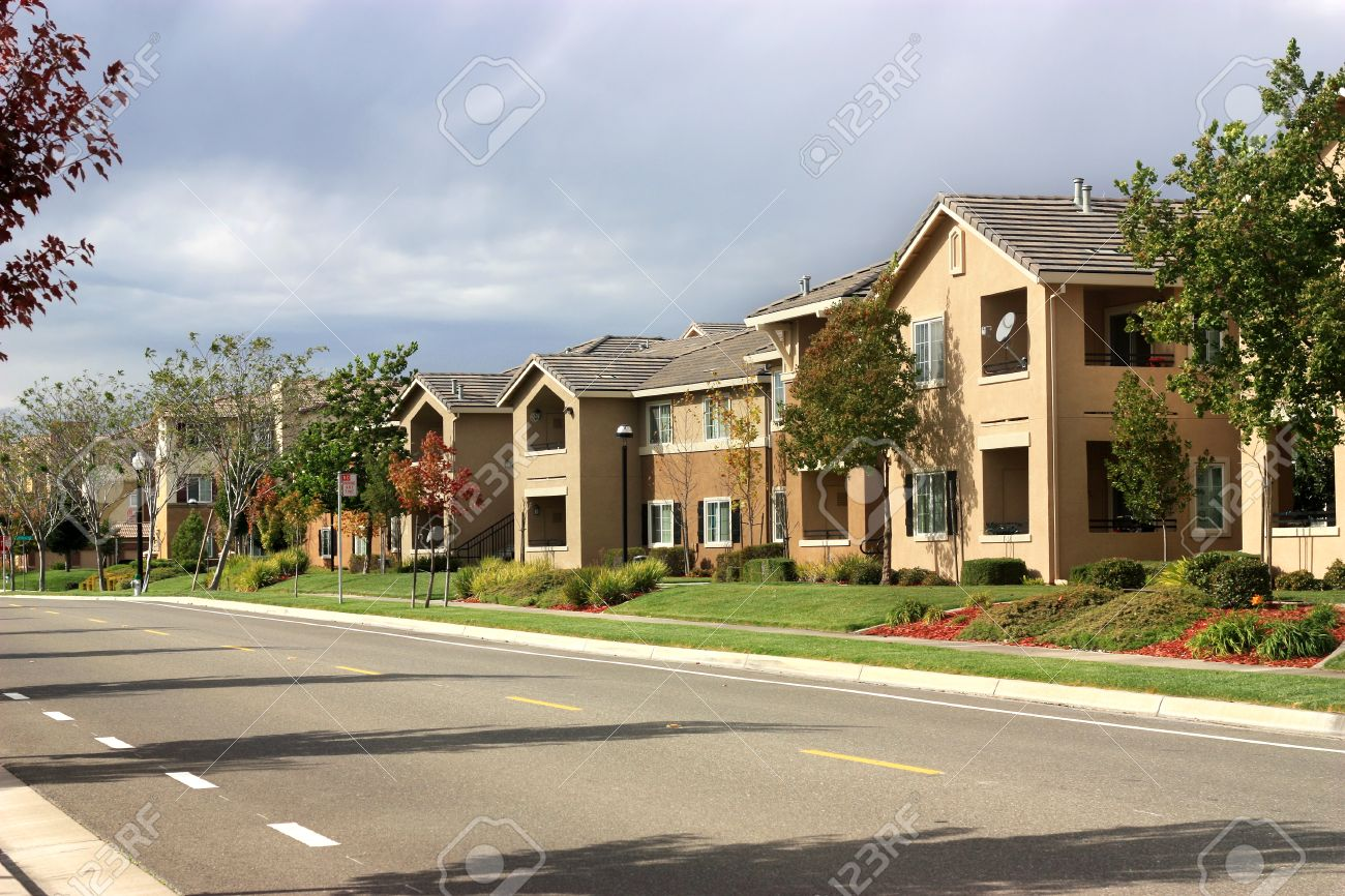 Apartment Complex modern apartment complex in suburban neighborhood stock photo