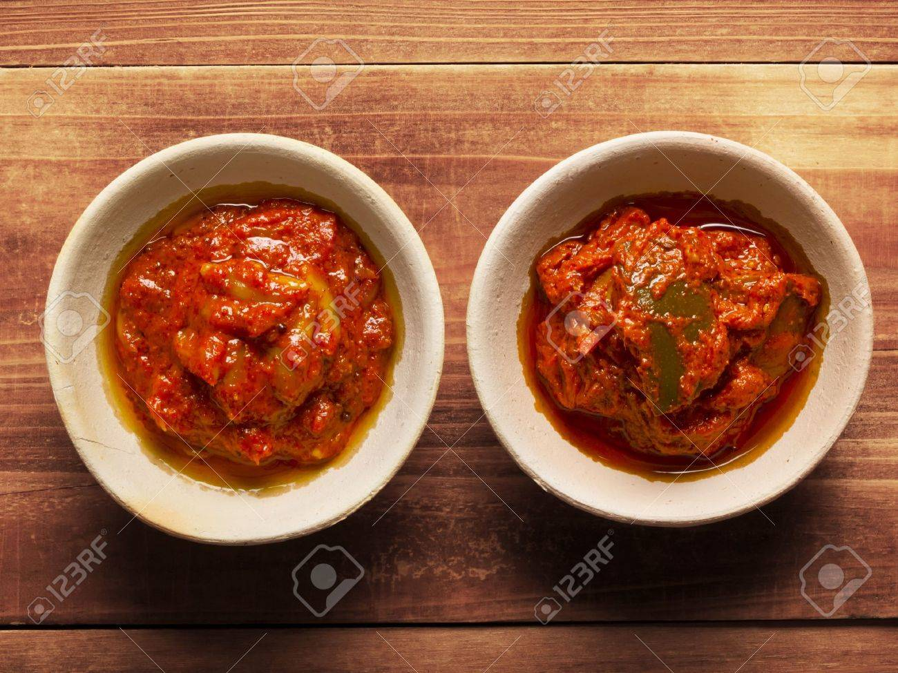 close up of bowls of indian pickles - 14263444