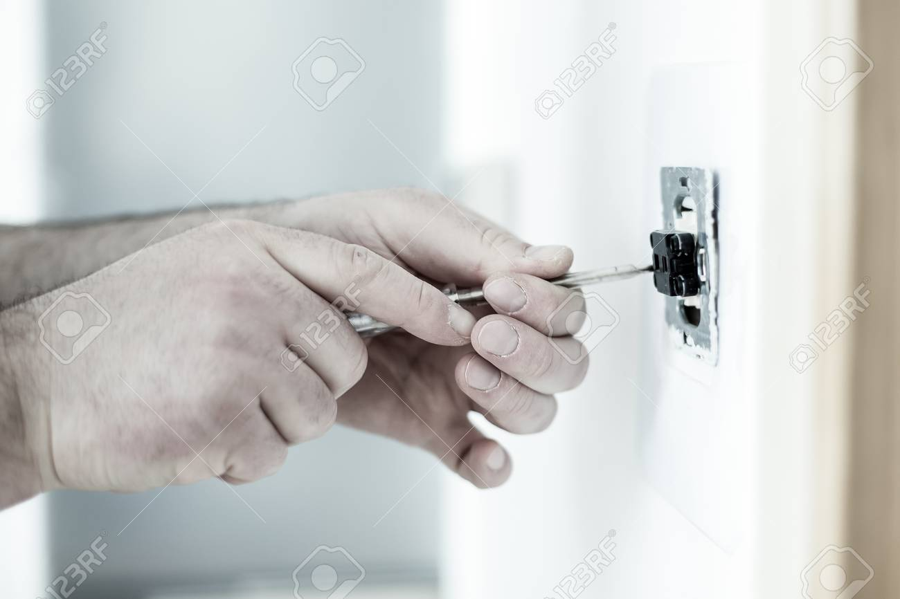 Man Installing Light Switch With Screwdriver After Home Renovation ...