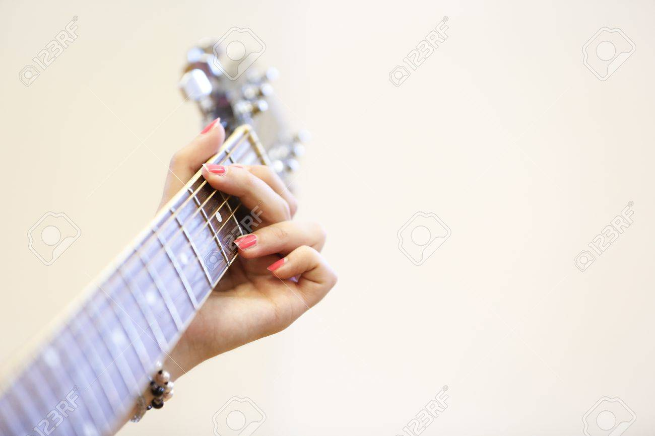 Woman Musician Holding A Guitar Learning Playing A G Chord