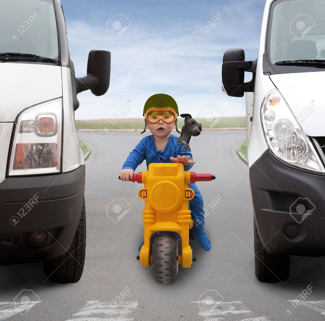 Small child on a motorcycle between two cars Stock Photo - 20112771