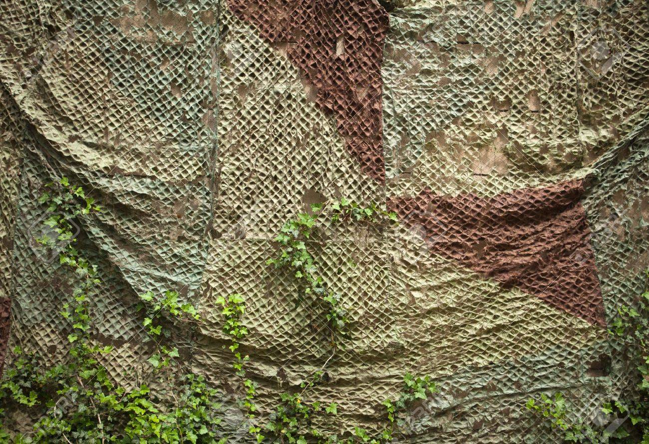 Old wall with camouflage net Stock Photo - 20957819