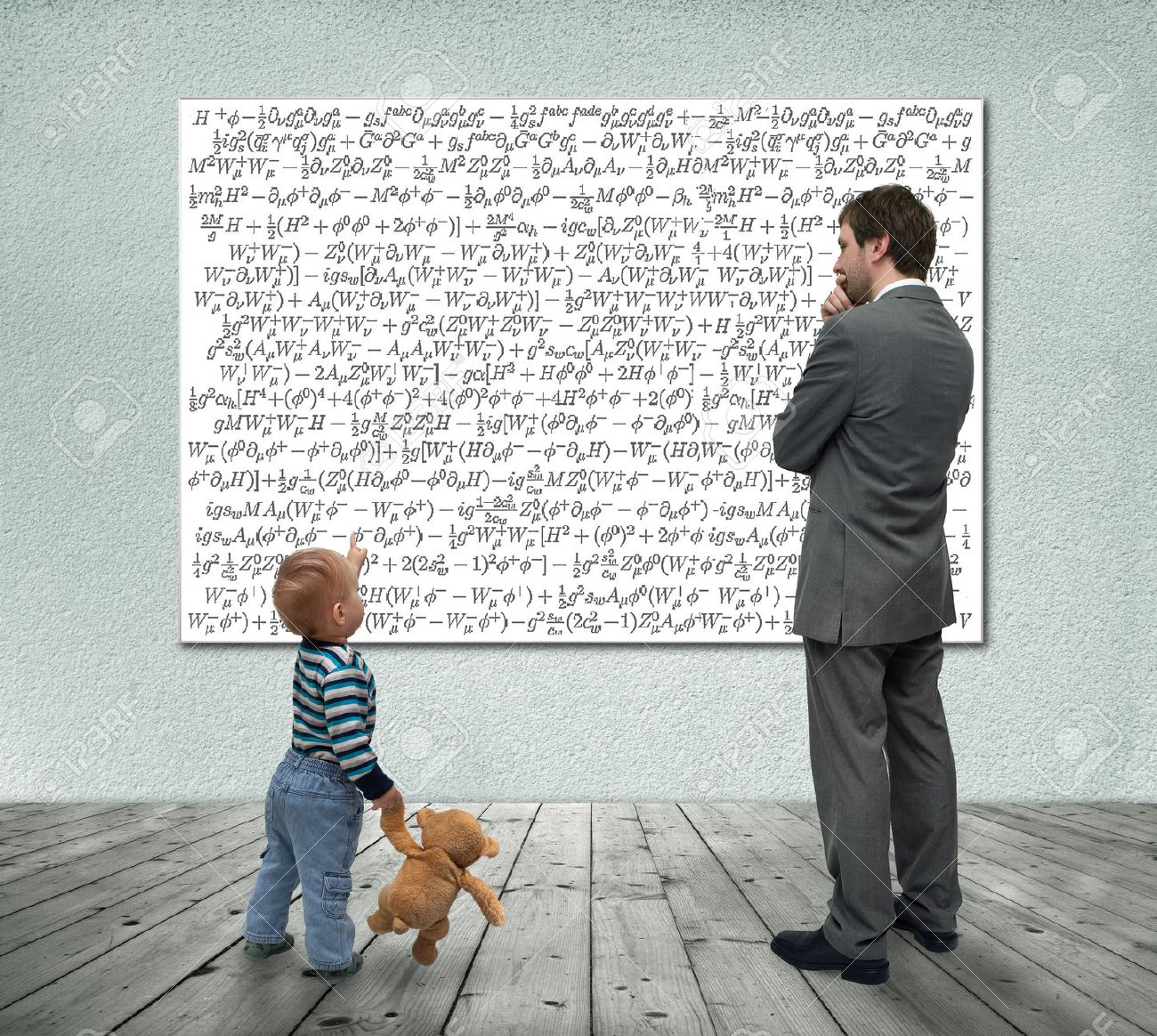 Small boy with businessman looking at board with mathematic formulas Stock Photo - 23666553