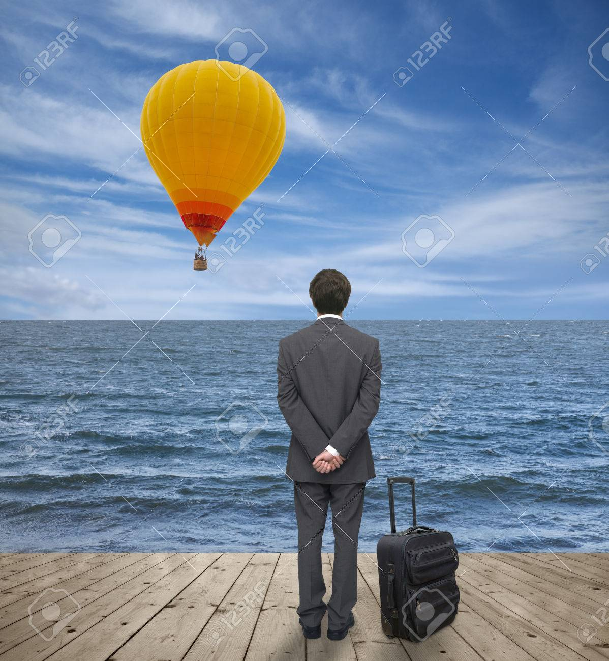 man with a suitcase observes balloon Stock Photo - 24929697
