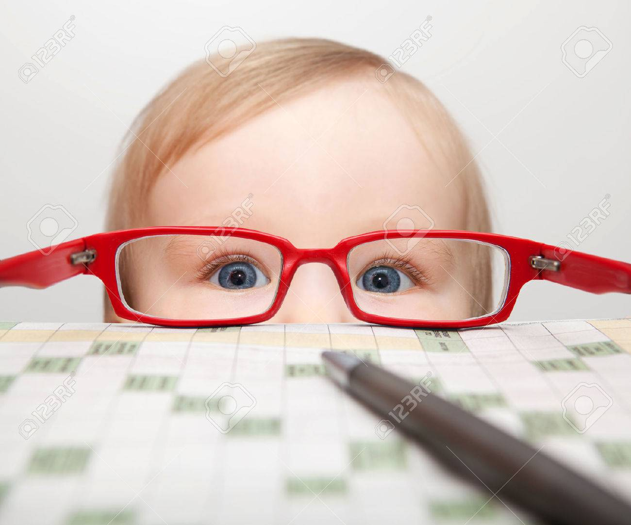 Little boy looking through glasses Stock Photo - 26535149