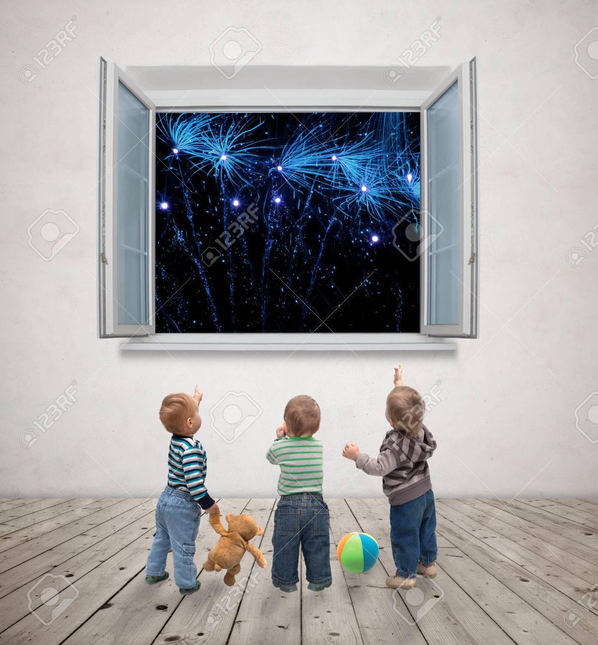 little kids watching fireworks Stock Photo - 27490652