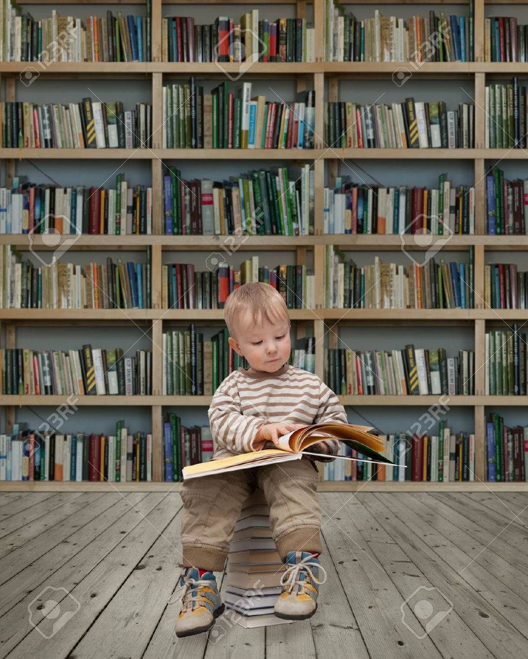 child reading a book in the library Stock Photo - 29223053