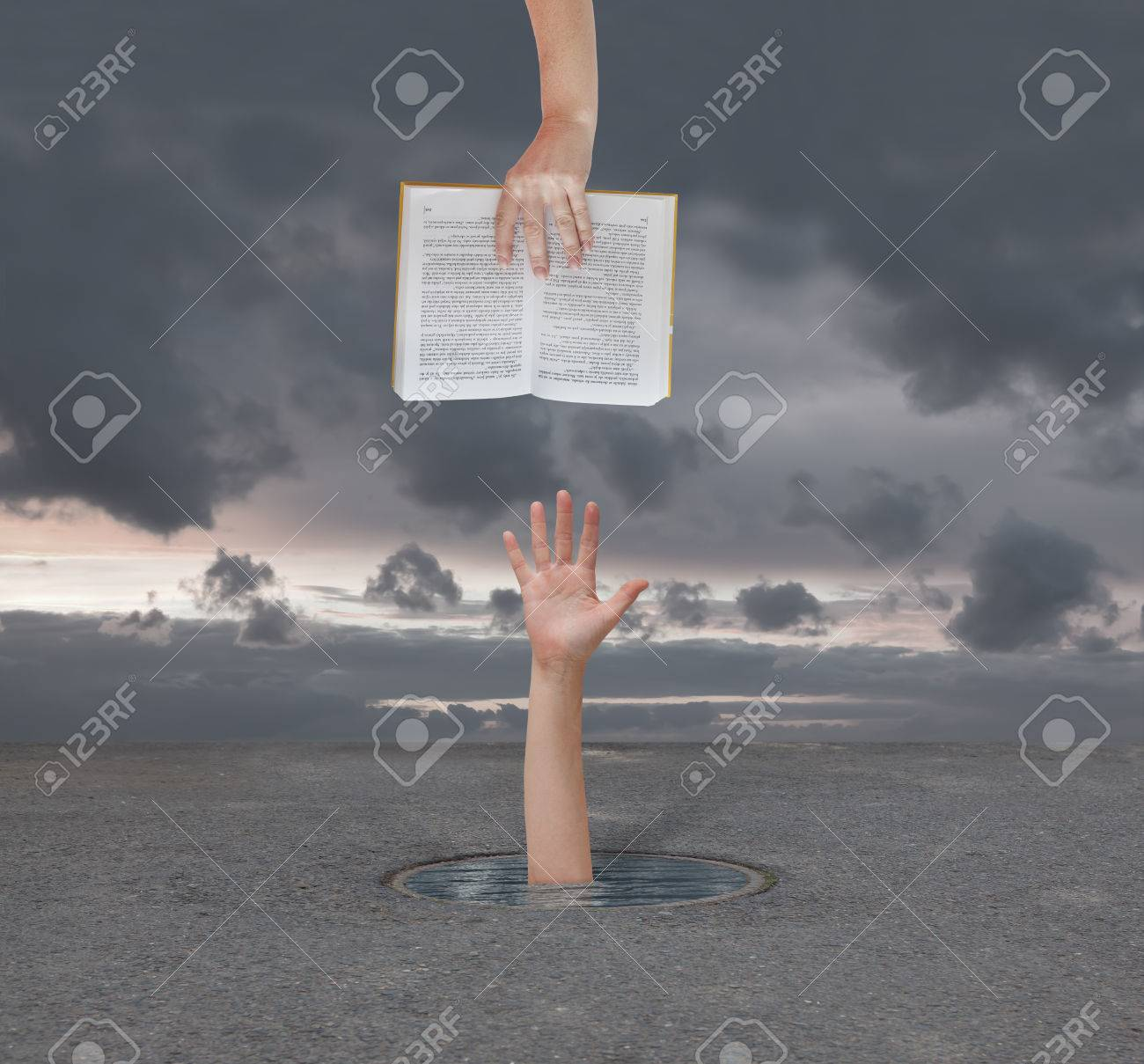 hand gives the book a man who is drowning Stock Photo - 33648129