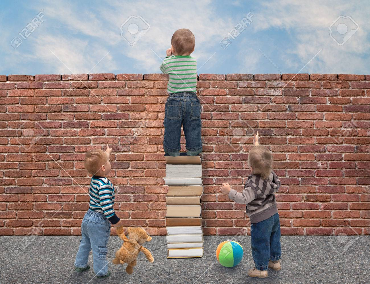 children perceive behind a wall of knowledge Stock Photo - 39091076