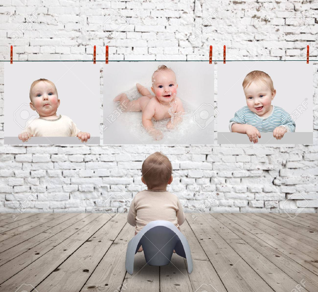 small child on the potty looking at photos Stock Photo - 43121827