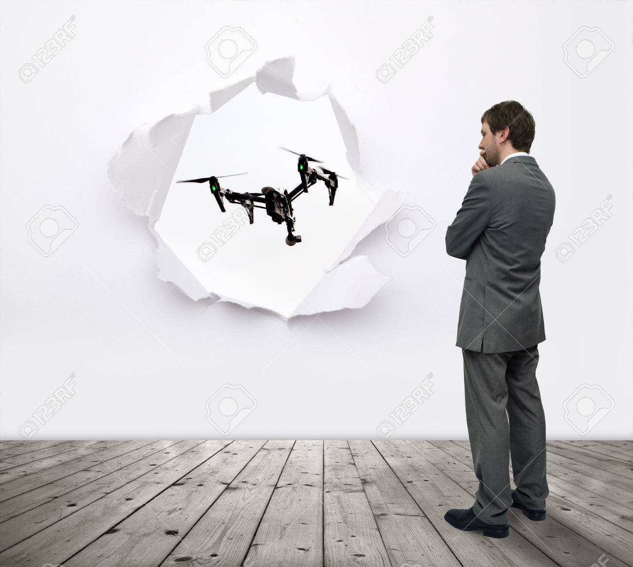 man in a suit watching drone Stock Photo - 54691479