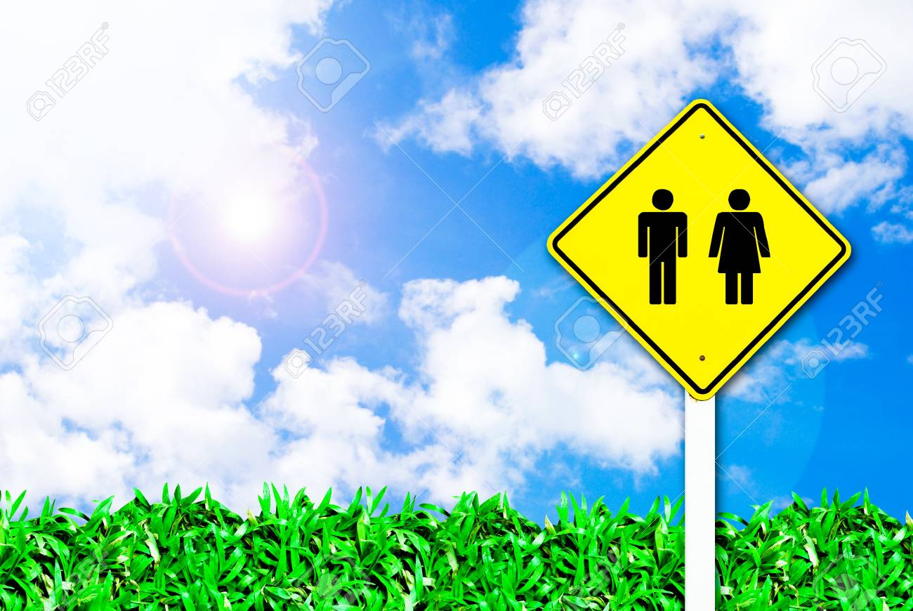 man and women sign on beautiful sky and grass field background Stock Photo - 8335037