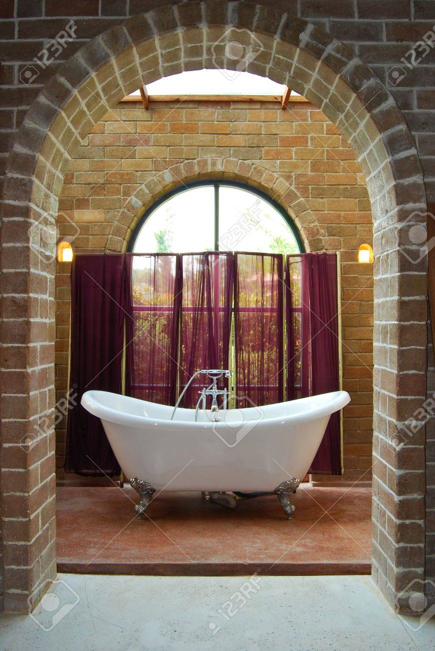 interior of vintage bathroom with bathtub in brick wall decoration