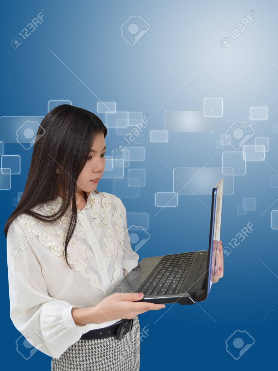 Business woman with laptop computer on blue background Stock Photo - 10444484