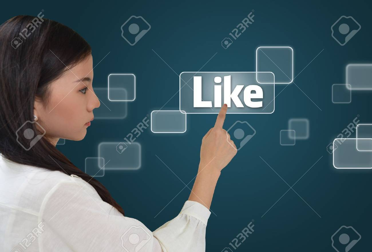 Business woman pressing like button on screen Stock Photo - 10472401
