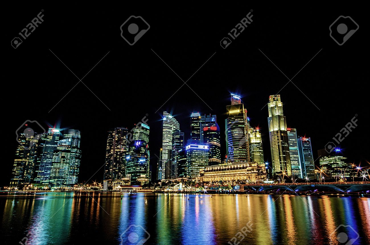Stock photo hamburg germany riverside new - Riverside Scene Singapore City Skyline View Of Business District In The Night Time With
