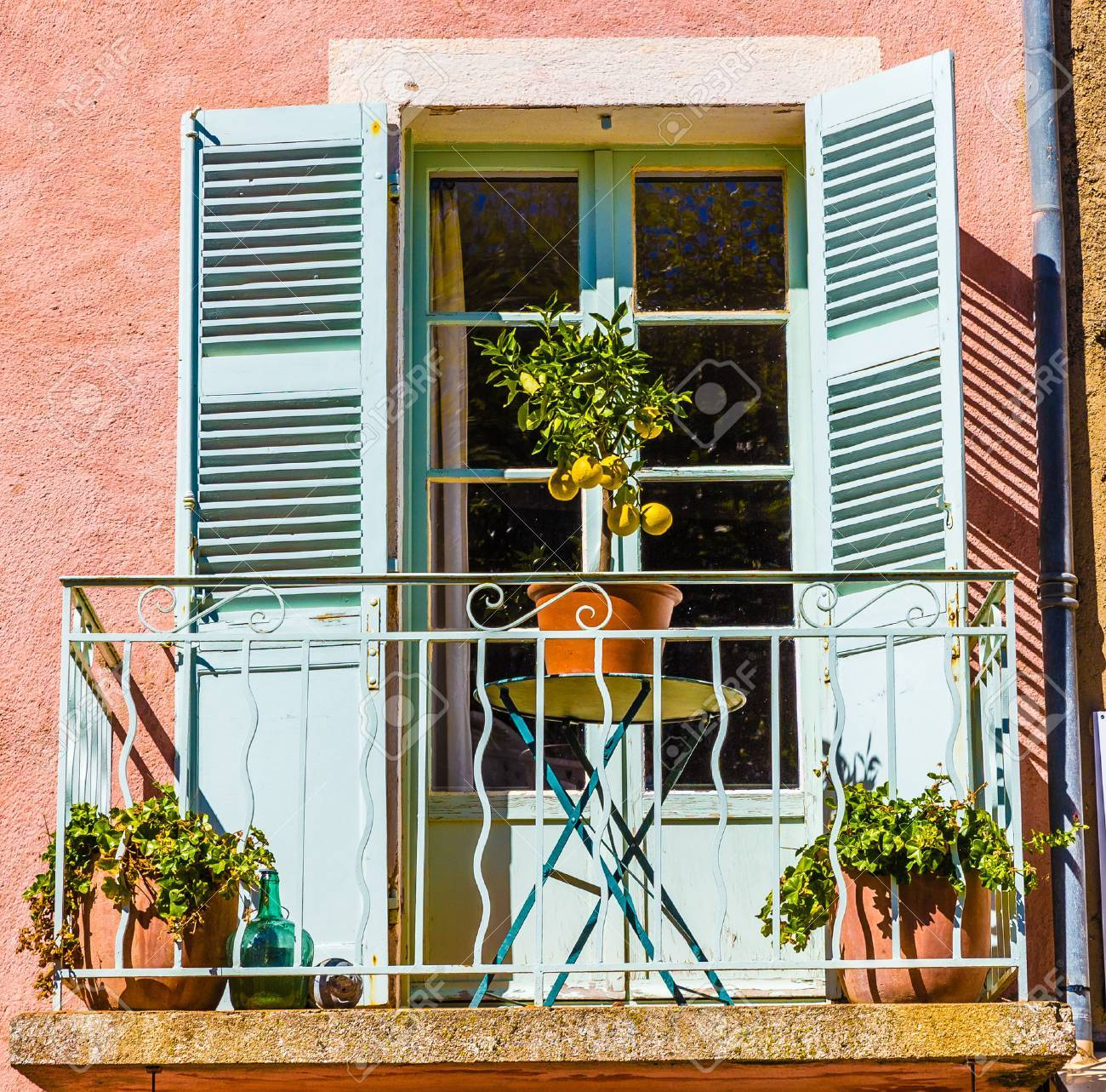 Detail Of Balcony With Green Door And Small Lemon Tree On The Table-Tourtour,France,Europe - 50455572