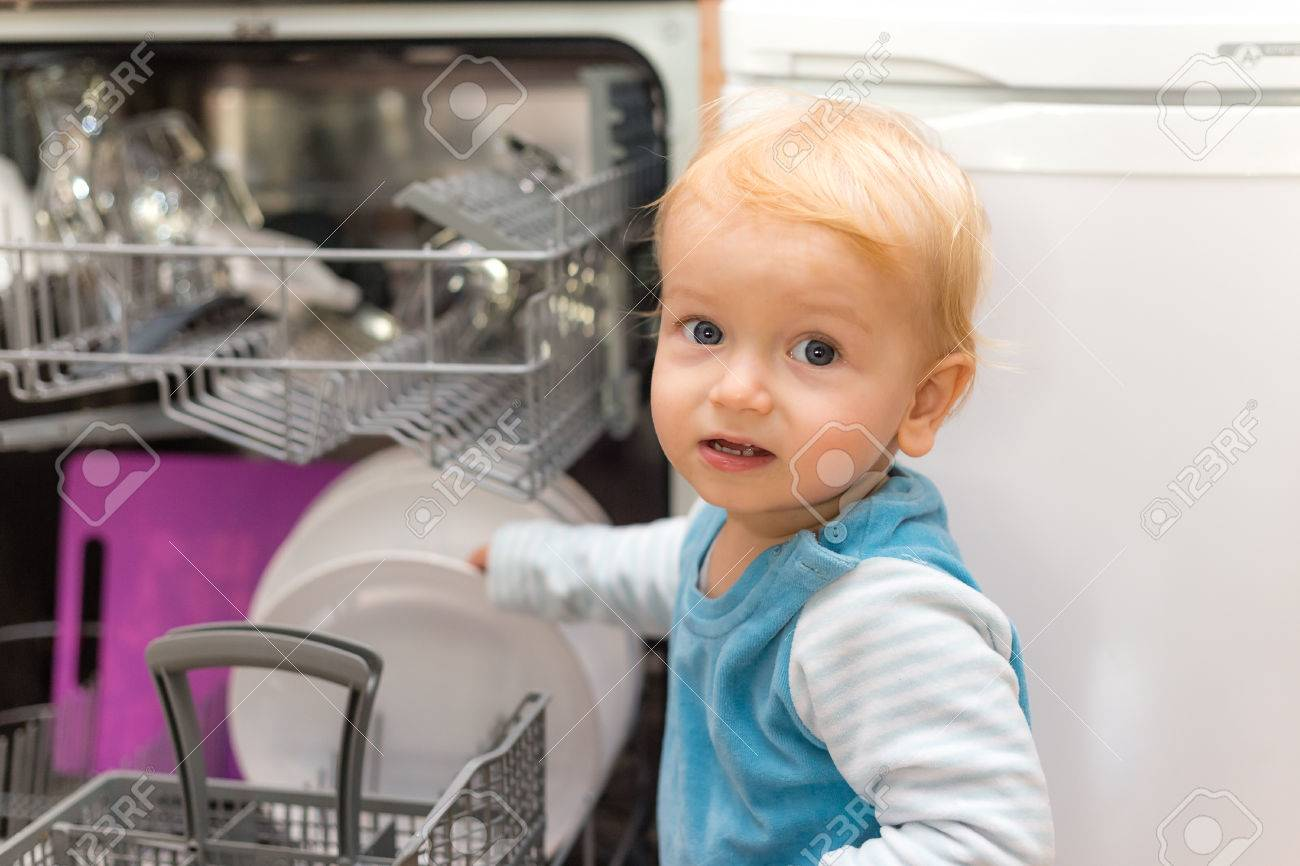 Adorable Little Blond Boy Putting Dishes Into The Dishwasher - 50476416