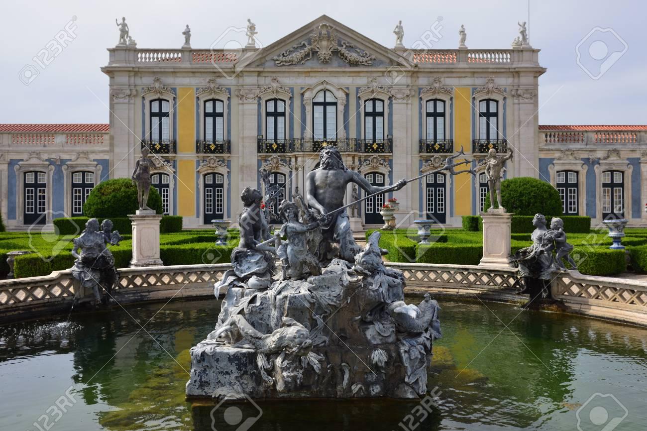 Neptune Gardens, Fountain (baroque) And The Facades Of The Queluz Royal  Palace.