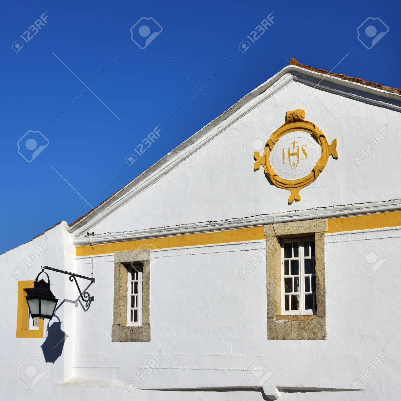 Ihs Sign Symbol Of The Jesuit Order On The White Wall Of The