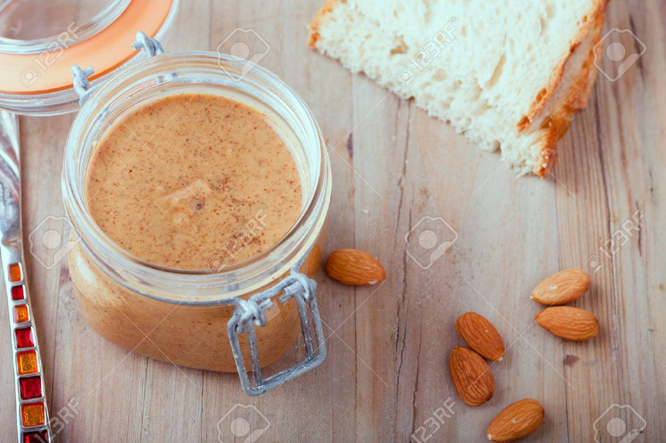 Raw Organic Almond Butter on a wooden rustic Background - 37455256