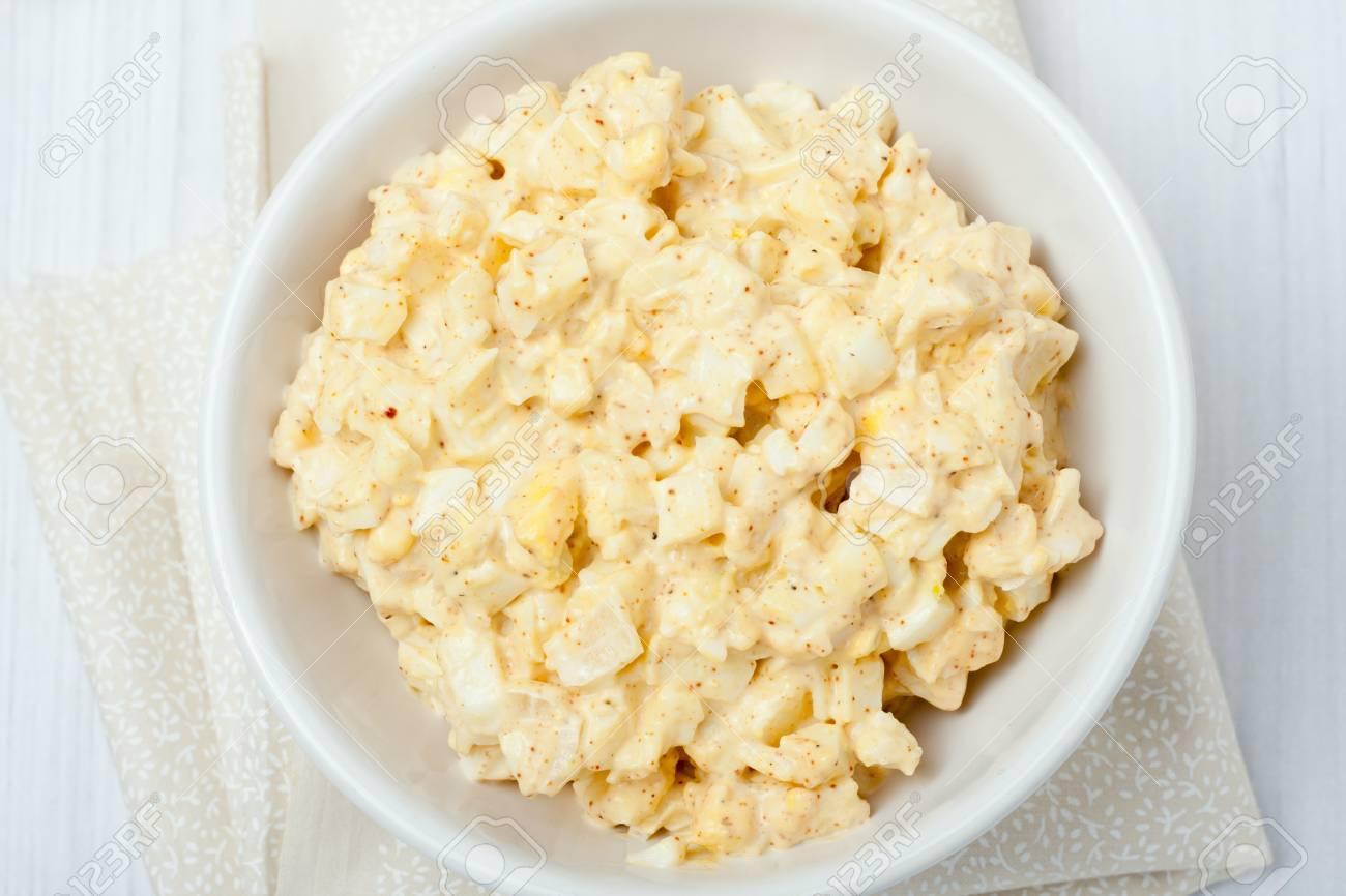 homemade egg salad in white bowl on white background - 38497447