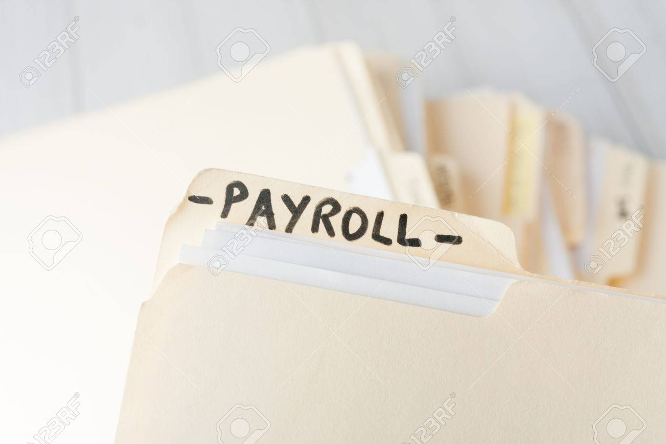 yellow paper folder labeled PAYROLL containing employee information of a small business firm - 38981554