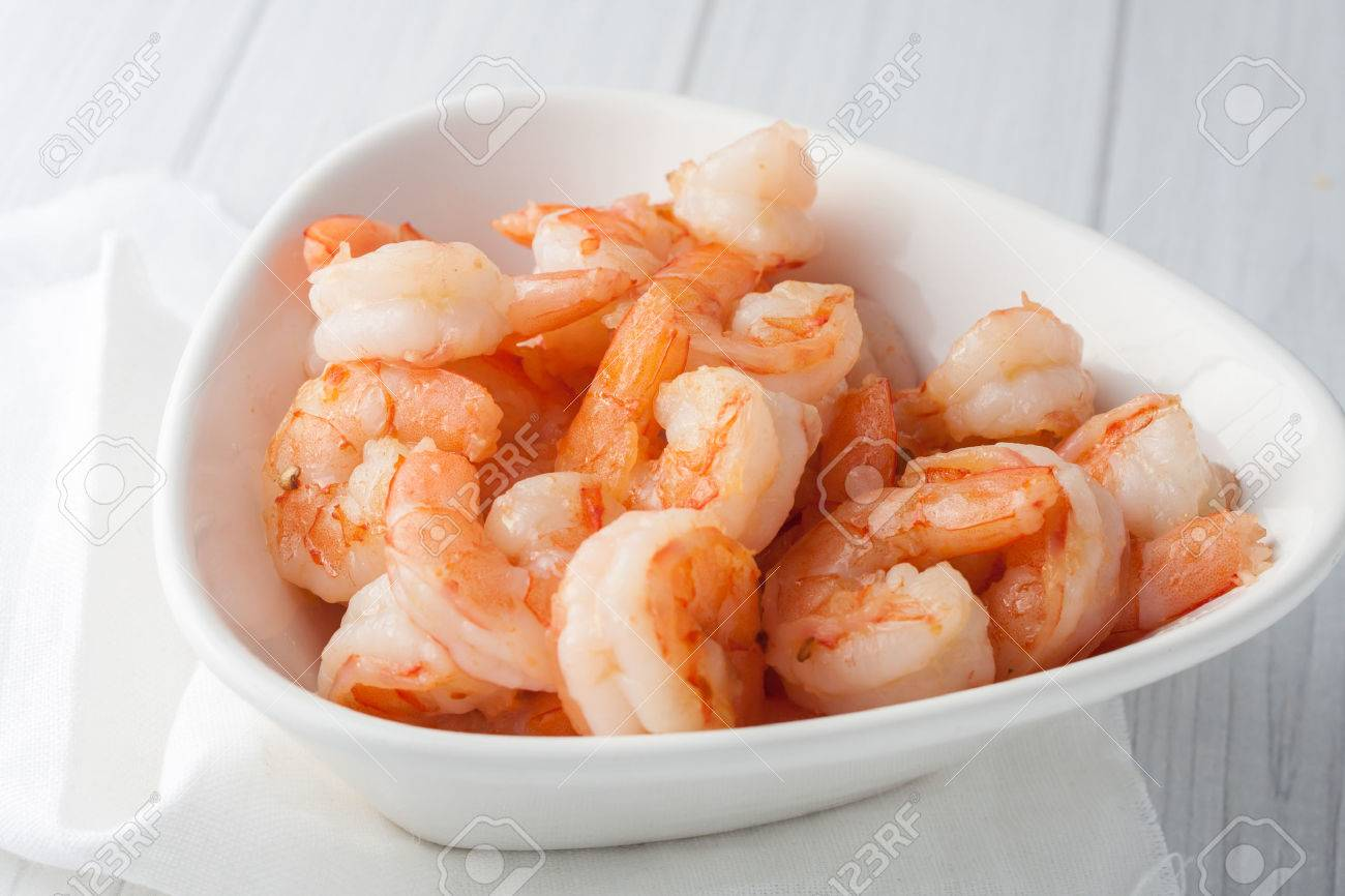close up of fresh cooked large shrimp or shrimpl coctail in white bowl - 39392137