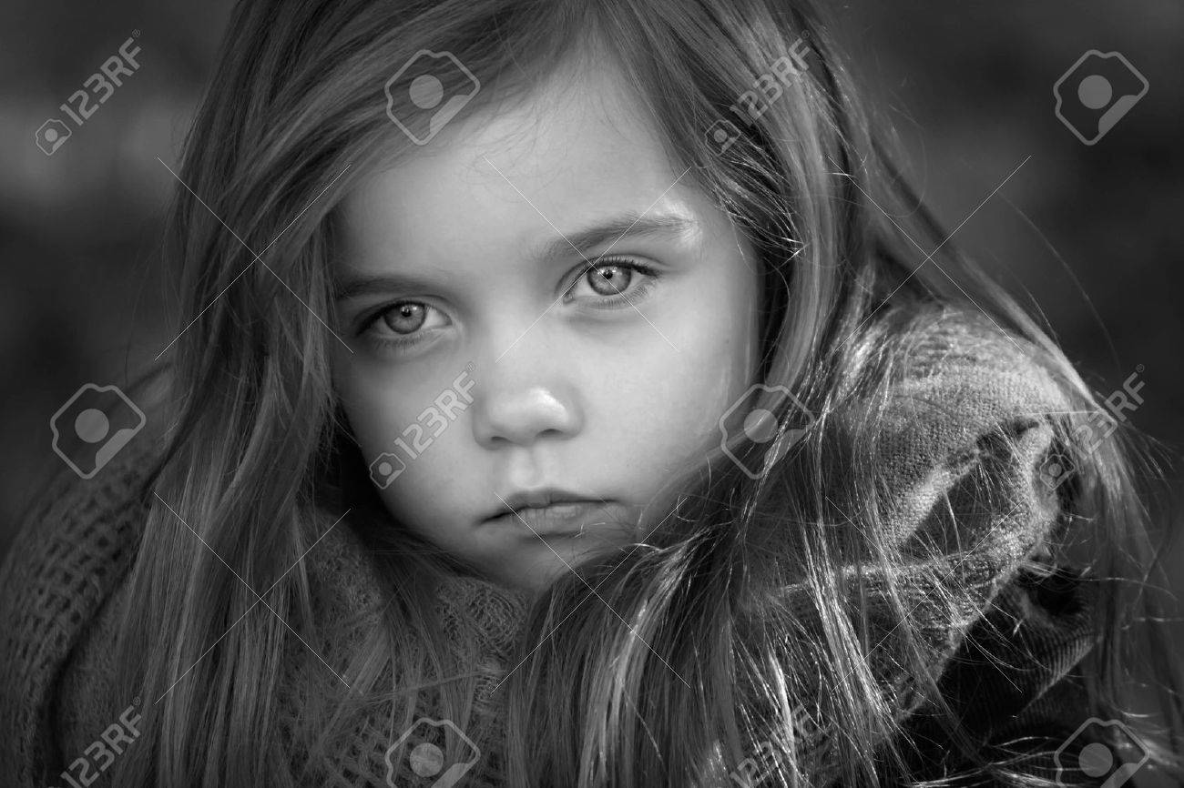 black and white portrait of a beautiful young girl with long hair taken outside - 47707033