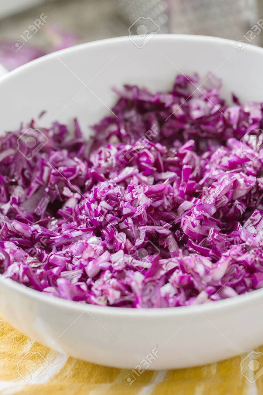 red cabbage shredded in white bowl - 120352044