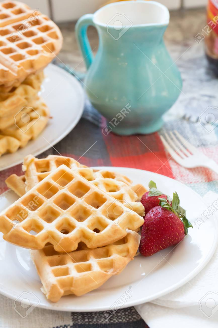 a stack of plain round waffles without toppings - 120352068