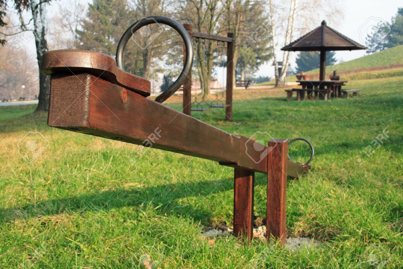 A Wooden Seesaw In A Park