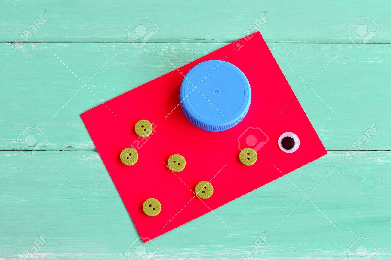 A Cap From A Plastic Bottle, Buttons, Cardboard Sheet, A Plastic ...
