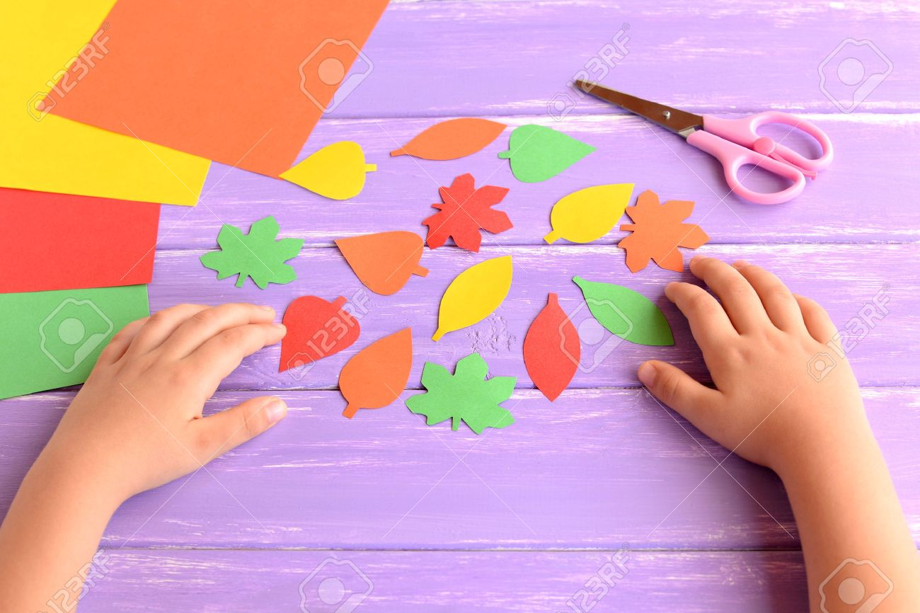 Child Cut Out Of Colored Paper Autumn Leaves Kid Doing Autumn