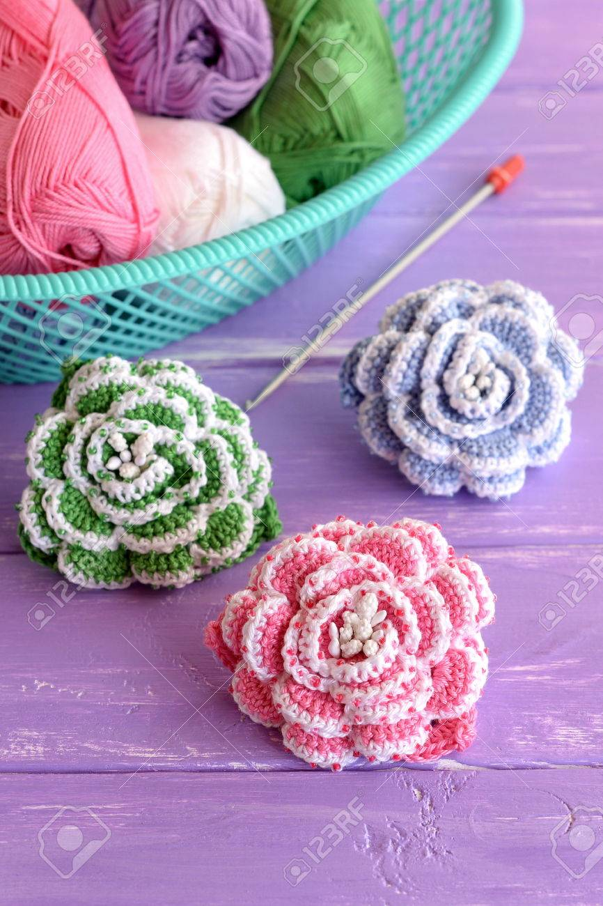 Pink green and blue crochet flowers decorated with beads cotton pink green and blue crochet flowers decorated with beads cotton yarn skeins in basket izmirmasajfo Image collections