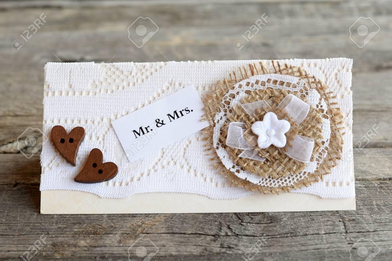 Beautiful Wedding Invitation On Old Wooden Background. Handmade ...