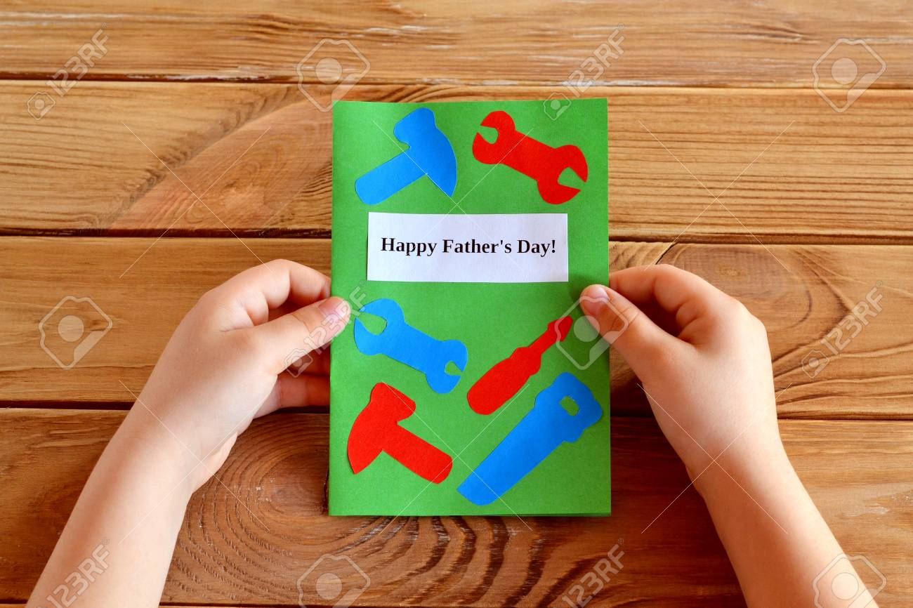 Child holds fathers day greeting card in his hands homemade stock child holds fathers day greeting card in his hands homemade fathers day greeting card idea m4hsunfo