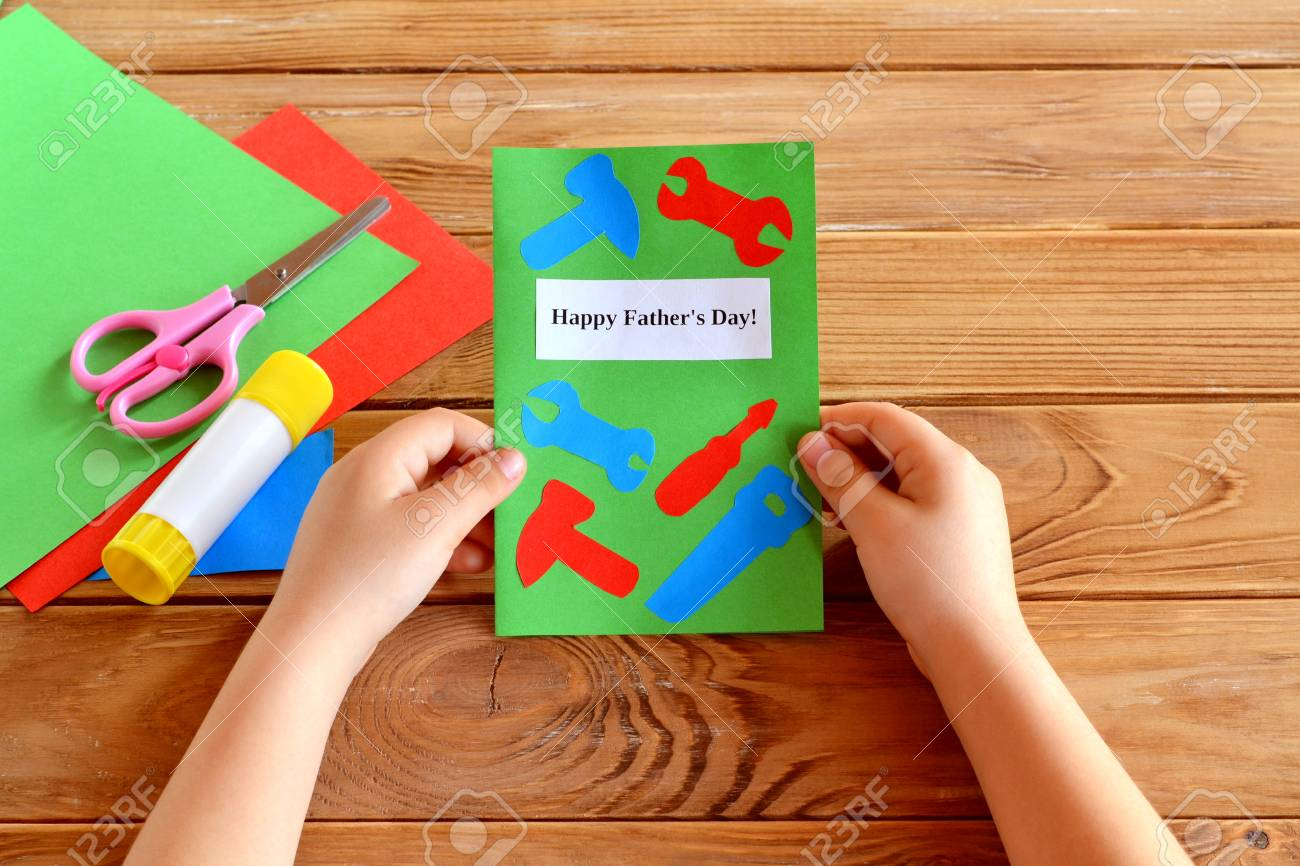 Child Holds Greeting Card In His Hands Happy Fathers Day Paper