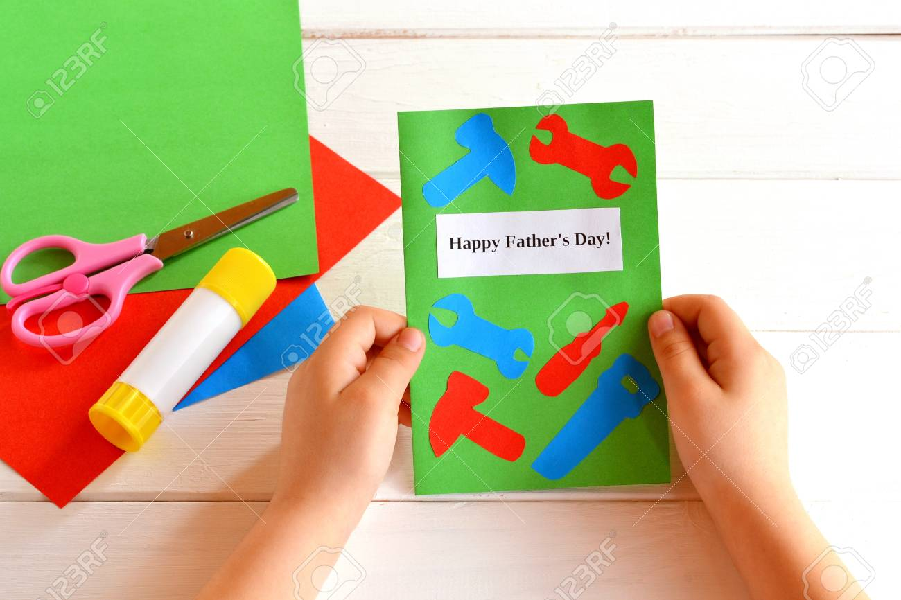 Little Girl Holds Greeting Card In His Hands Happy Fathers Stock
